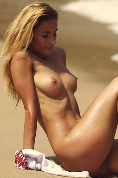 Model Cara Mell in Sand And Surf